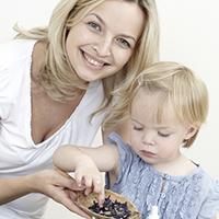 Dame med barn og urter